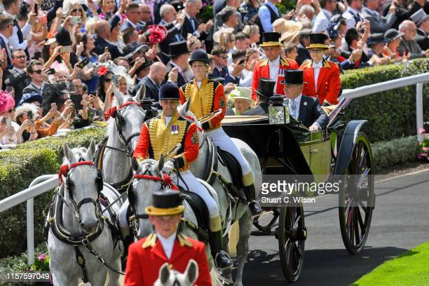 Queen Elizabeth II and Prince Andrew, Duke of York during the Royal Procession in the Parade Ring on day 5 of Royal Ascot at Ascot Racecourse on June...
