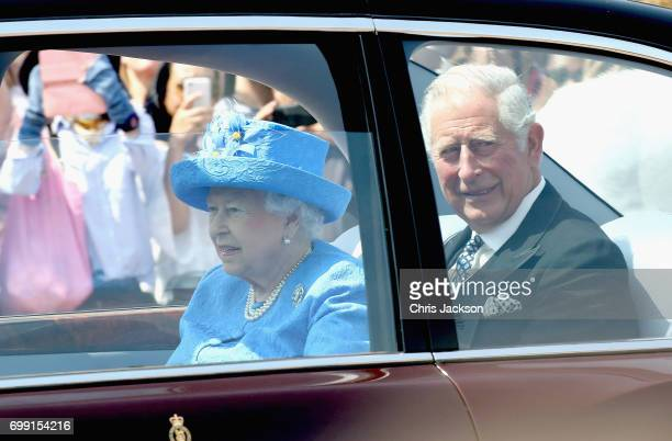 Queen Elizabeth II and Prince Charles Prince of Wales are driven from Buckingham Palace to the House of Lords at the Palace of Westminster ahead of...