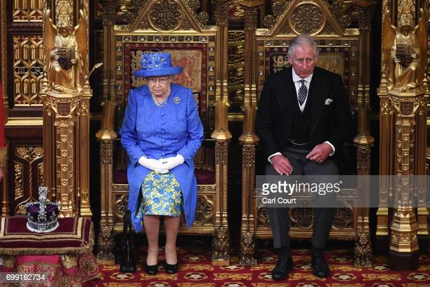 Queen Elizabeth II and Prince Charles Prince of Wales arrive in the House of Lords at Houses of Parliament on June 21 2017 in London England This...