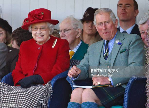 Queen Elizabeth II and Prince Charles Prince of Wales attend the Braemar Gathering at The Princess Royal and Duke of Fife Memorial Park on September...