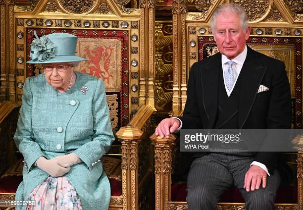 Queen Elizabeth II and Prince Charles, Prince of Wales attend the State Opening of Parliament in the House of Lord's Chamber on December 19, 2019 in...