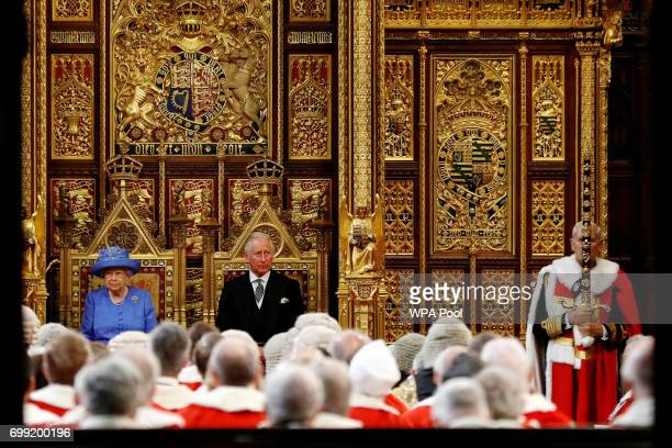 Queen Elizabeth II and Prince Charles Prince of Wales attend the State Opening Of Parliament in the House of Lords on June 21 2017 in London England...