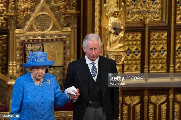 Queen Elizabeth II and Prince Charles, Prince of Wales attend the State Opening Of Parliament in the House of Lords at the Palace of Westminster on...