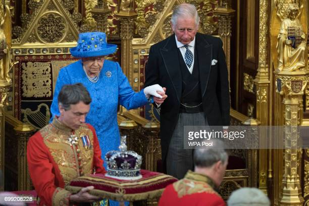 Queen Elizabeth II and Prince Charles Prince of Wales attend the State Opening Of Parliament in the House of Lords at the Palace of Westminster on...