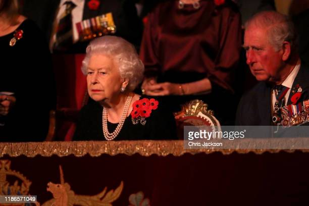 Queen Elizabeth II and Prince Charles Prince of Wales attend the annual Royal British Legion Festival of Remembrance at the Royal Albert Hall on...