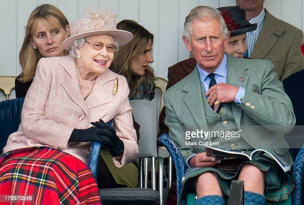 Queen Elizabeth II and Prince Charles Prince of Wales attend the annual Braemer Highland Games at The Princess Royal and Duke of Fife Memorial Park...