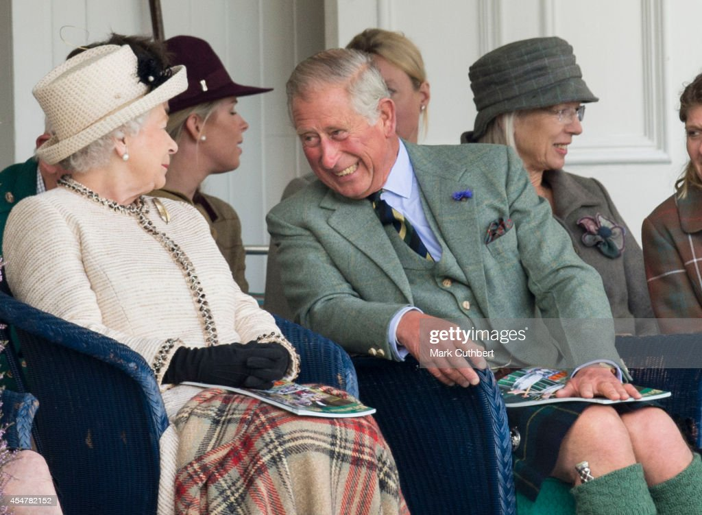 Queen Elizabeth II and Prince Charles, Prince of Wales attend the annual Braemar Highland Games on September 6, 2014 in Braemar, Scotland.