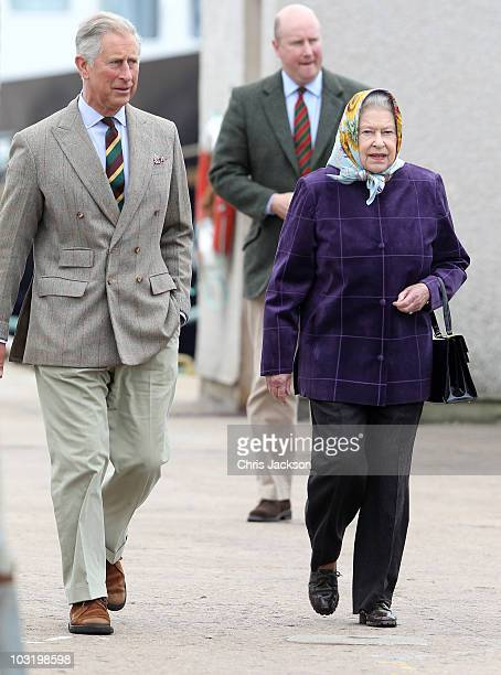 Queen Elizabeth II and Prince Charles Prince of Wales disembark the Hebridean Princess with other members of the Royal Family in Scrabster Harbour on...