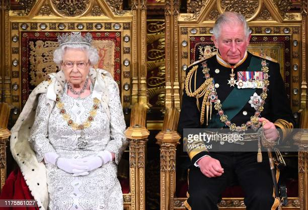Queen Elizabeth II and Prince Charles Prince of Wales during the State Opening of Parliament at the Palace of Westminster on October 14 2019 in...