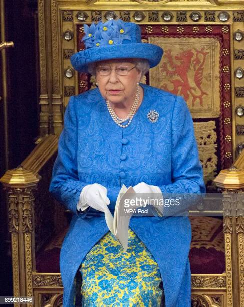 Queen Elizabeth II and Prince Charles Prince of Wales during the State Opening of Parliament in the House of Lords at the Palace of Westminster on...