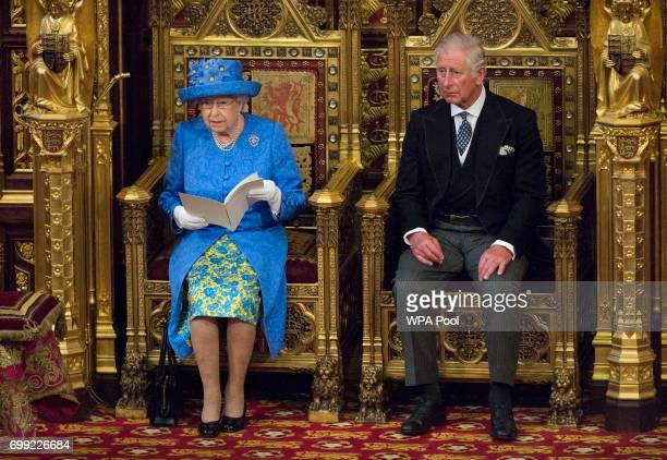 Queen Elizabeth II and Prince Charles Prince of Wales sit during the State Opening of Parliament in the House of Lords at the Palace of Westminster...