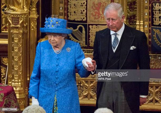 Queen Elizabeth II and Prince Charles Prince of Wales stand during the State Opening of Parliament in the House of Lords at the Palace of Westminster...