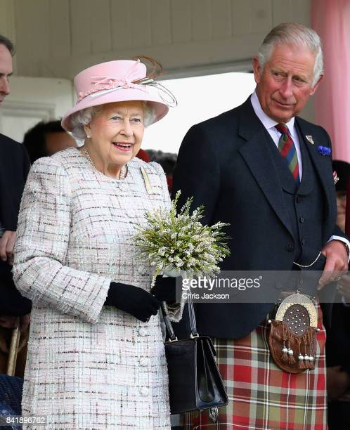 Queen Elizabeth II and Prince Charles Prince of Wales watch the 2017 Braemar Gathering at The Princess Royal and Duke of Fife Memorial Park on...