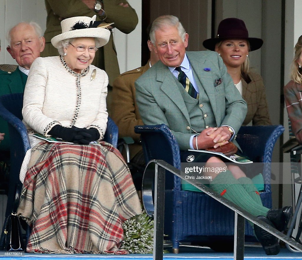 Queen Elizabeth II and Prince Charles, Prince of Wales watch the action during the Braemar Highland Games on September 6, 2014 in Braemar, Scotland. The Braemar Gathering is the most famous of the Highland Games and is known worldwide. Each year thousands of visitors descend on this small Scottish village on the first Saturday in September to watch one of the more colourful Scottish traditions. The Gathering has a long history and in its modern form it stretches back nearly 200 years