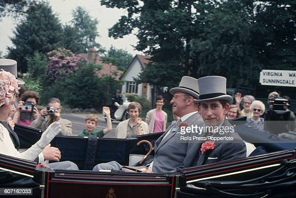 Queen Elizabeth II and Prince Charles ride together in a royal carriage to Ascot Racecourse during Royal Ascot week in Berkshire England in June 1968