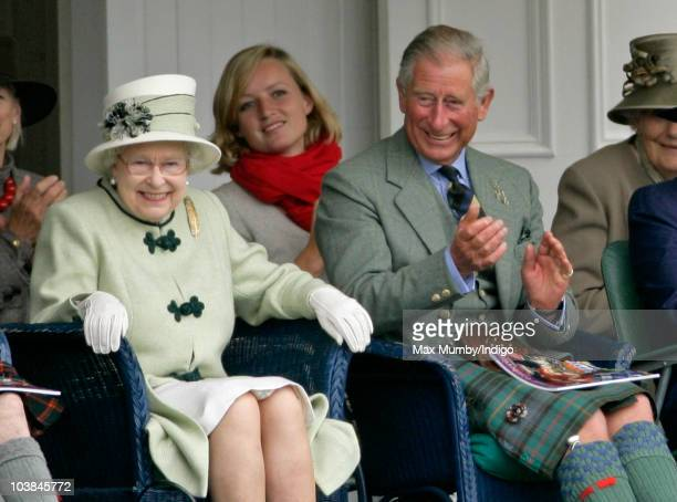 Queen Elizabeth II and Prince Charles The Prince of Wales laugh as they watch the tug of war competition as they attend the Braemar Highland Games at...