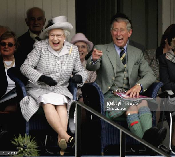 Queen Elizabeth II and Prince Charles The Prince of Wales laugh as they watch competitors during the Braemar Gathering at the Princess Royal and Duke...