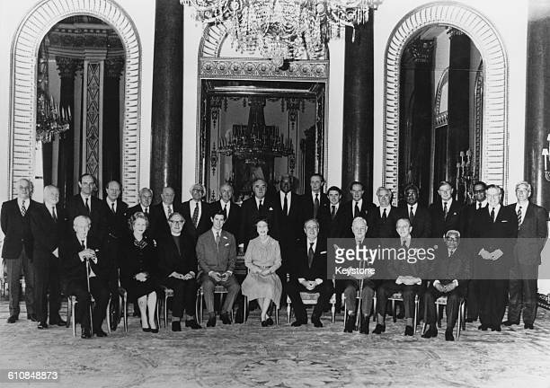 Queen Elizabeth II and Prince Charles with members of the Privy Council after a meeting at Buckingham Palace London 27th March 1981 Front row left to...