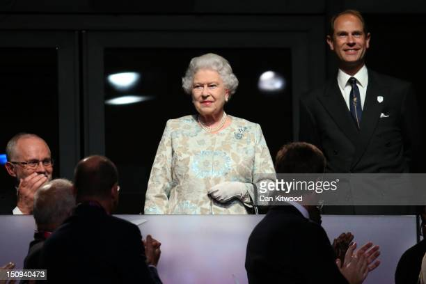 Queen Elizabeth II and Prince Edward Earl of Wessex look on during the Opening Ceremony of the London 2012 Paralympics at the Olympic Stadium on...