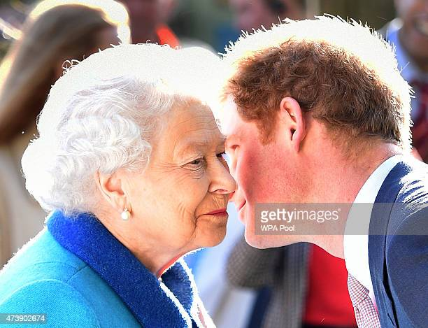 Queen Elizabeth II and Prince Harry attend at the annual Chelsea Flower show at Royal Hospital Chelsea on May 18 2015 in London England