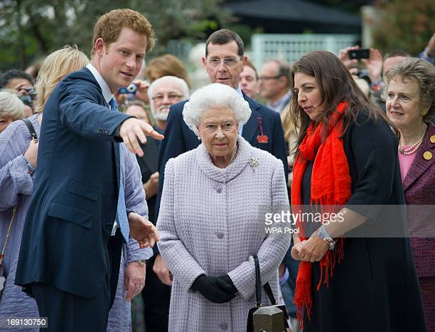 Queen Elizabeth II and Prince Harry visit the Sentebale Forgetmenot garden the Chelsea Flower Show press and VIP preview day at Royal Hospital...