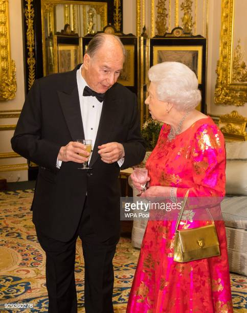 Queen Elizabeth II and Prince Karim Aga Khan IV prior to dinner at Windsor Castle on March 8 2018 in Windsor England Queen Elizabeth II is hosting...