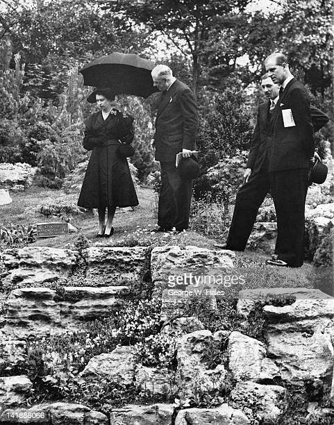 Queen Elizabeth II and Prince Philip admiring the rock garden at the Chelsea Flower Show London 20th May 1952 The garden was designed by Winkfield...