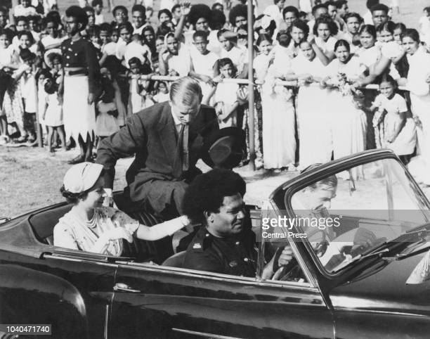Queen Elizabeth II and Prince Philip are driven to a sports meeting in Lautoka Fiji during the coronation world tour 28th December 1953