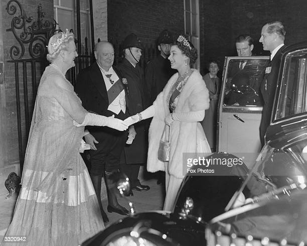 Queen Elizabeth II and Prince Philip are greeted by Sir Winston and Lady Churchill as they arrive outside 10 Downing Street for a dinner party at the...