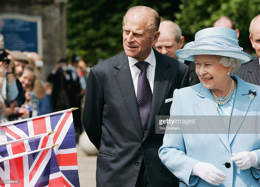 Queen Elizabeth II and Prince Philip are greeted by Union Jack flags during a walkabout on June 8, 2007 in Romsey, England.