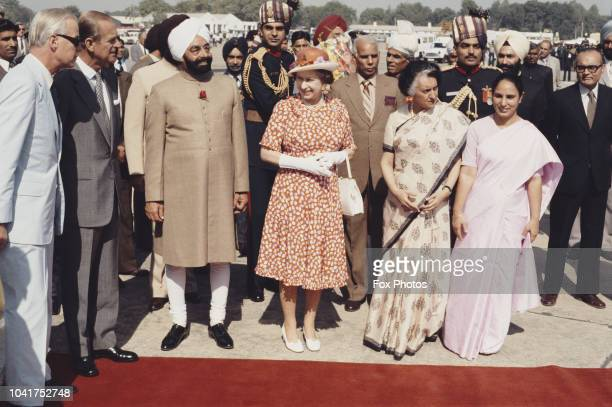 Queen Elizabeth II and Prince Philip are met by Indian Prime Minister Indira Gandhi and President Zail Singh at Palam Airport, New Delhi, during a...