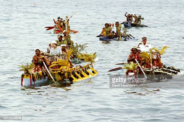 Queen Elizabeth II and Prince Philip are rowed on local canoes to the Vaiaku maneapa of Funfuti in Tuvalu on October 26 1982 during the Royal Tour of...