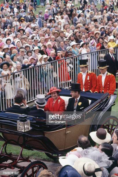 Queen Elizabeth II and Prince Philip arrive at Ascot Races in a carriage procession 17th June 1980
