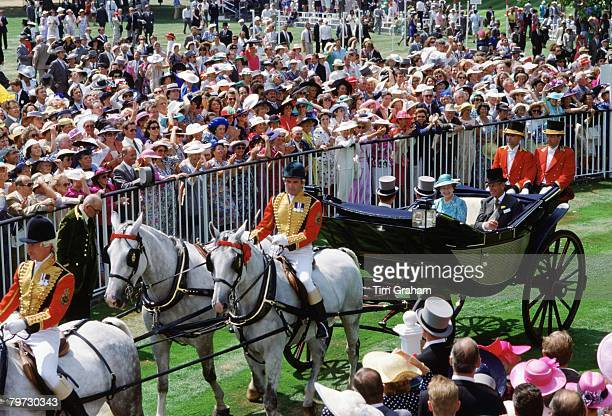 Queen Elizabeth II and Prince Philip arrive at Ascot Races in a carriage procession