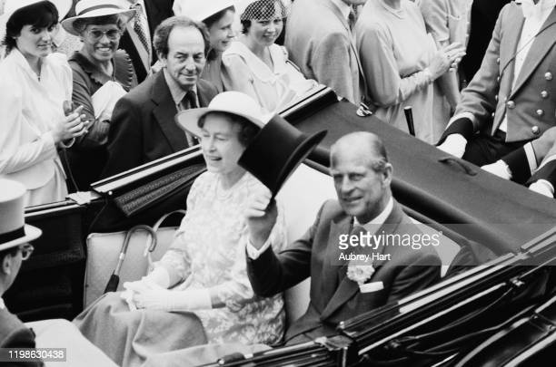 Queen Elizabeth II and Prince Philip arrive at the Royal Ascot meeting, at Ascot racecourse, in Ascot, Berkshire, UK, 19th June 1984.