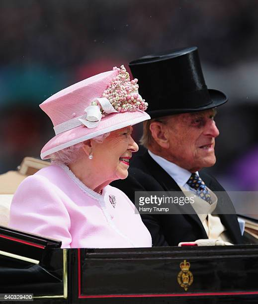 Queen Elizabeth II and Prince Philip arrive during the Royal Procession during Day Two of Royal Ascot 2016 at Ascot Racecourse on June 15 2016 in...