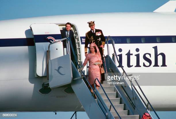 Queen Elizabeth II and Prince Philip arriving in Kuwait by concorde accompanied by Dr Davidowen.