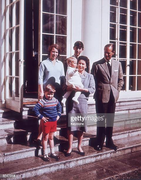 Queen Elizabeth II and Prince Philip at Windsor Castle with their children, Prince Charles, Princess Anne, Prince Andrew and little Prince Edward.