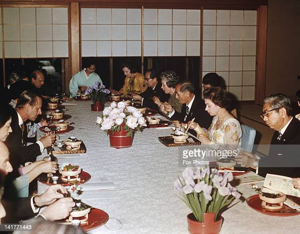 Queen Elizabeth II and Prince Philip attend a banquet during a State Visit to Japan May 1975