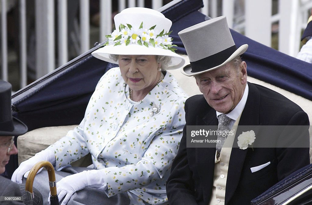 Queen Elizabeth II and Prince Philip attend Ladies Day on the third day of Royal Ascot at the Ascot Racecourse on June 17, 2004 in Berkshire, England. The event has been one of the highlights of the racing and social calendar since 1711.