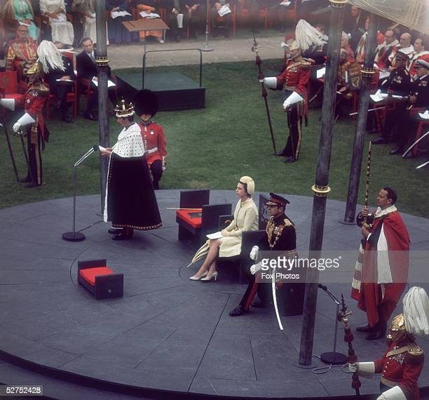 Queen Elizabeth II and Prince Philip attend the investiture of their son Charles as Prince of Wales at Caernarvon Castle in Wales 1st July 1969