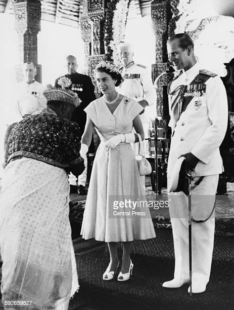 Queen Elizabeth II and Prince Philip being welcomed by a Kandyan Chief during their Royal Tour in Kandy April 23rd 1954