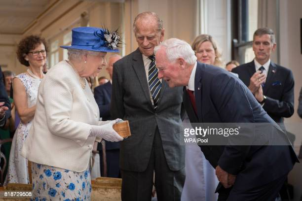 Queen Elizabeth II and Prince Philip, Duke of Cambridge are welcomed to Canada House by Canada Governor General David Johnston for her visit to...