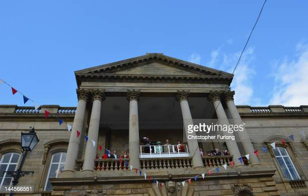Queen Elizabeth II and Prince Philip Duke of Edinbugh stand on the balcony of Accrington town hall as they review a parade as part of her Diamond...