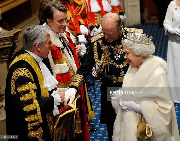 Queen Elizabeth II and Prince Philip Duke of Edinburg greet Secretary of State for Business Peter Mandelson and Justice Secretary Jack Straw during...