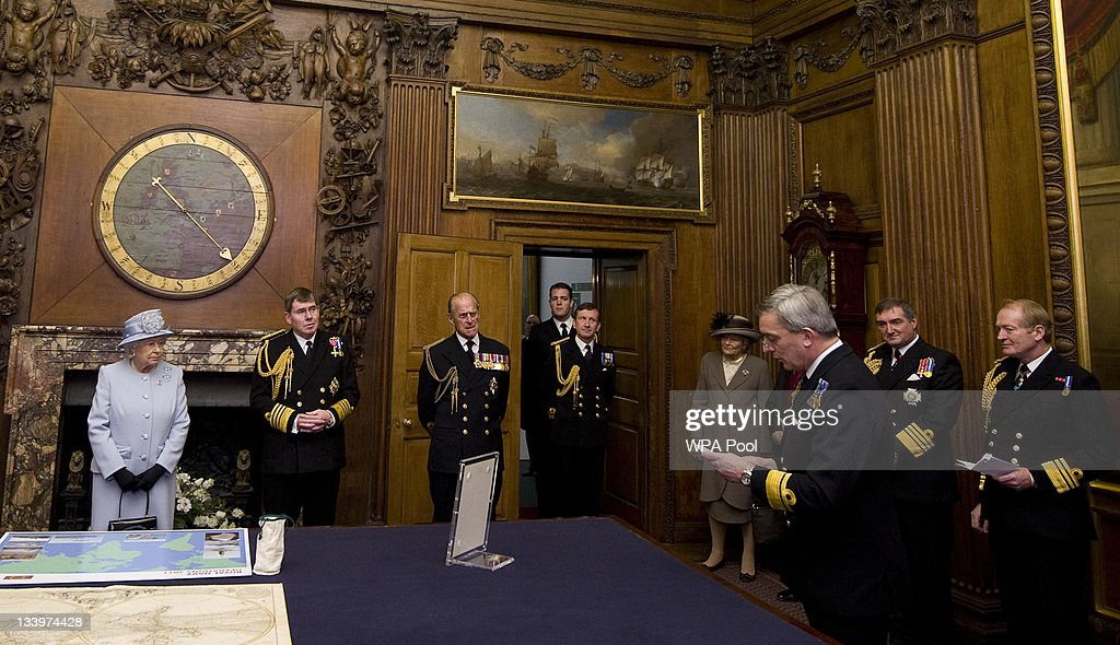 Queen Elizabeth II (L) and Prince Philip, Duke of Edinburgh (3L) accompaied by First Sea Lord, Admiral Sir Mark Stanhope (2L) are given a speech on recent naval history during a visit to the Admiralty Board and Admiralty House on 23 November, 2011 in London, England. The Duke of Edinburgh was inaugurated as Lord High Admiral as well as formally receiving the Letters Patent, followed by a lunch given by the First Sea Lord at Admiralty House.