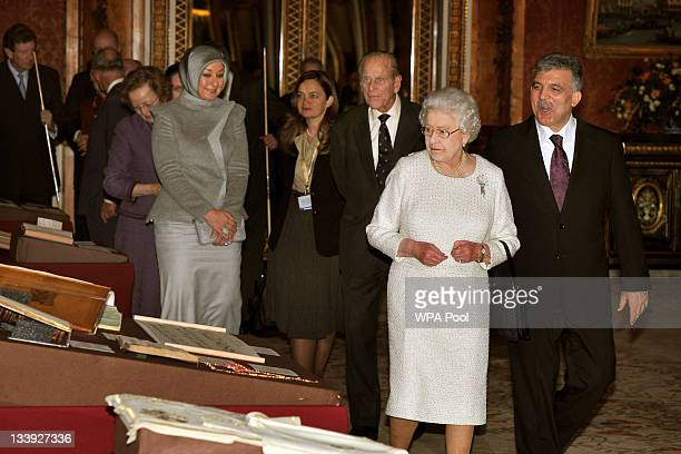 Queen Elizabeth II and Prince Philip Duke of Edinburgh accompany the President of Turkey Abdullah Gull and his wife Hayrunnisa as they tour an...