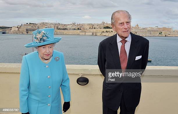 Queen Elizabeth II and Prince Philip Duke of Edinburgh after looking at the view from the Kalkara heritage site in Valletta Harbour on November 28...