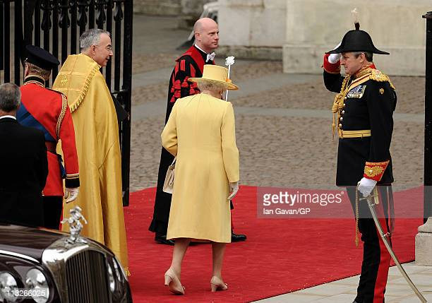 Queen Elizabeth II and Prince Philip Duke of Edinburgh and The Right Reverend Dr John Hall Dean of Westminster make their way into the Royal Wedding...