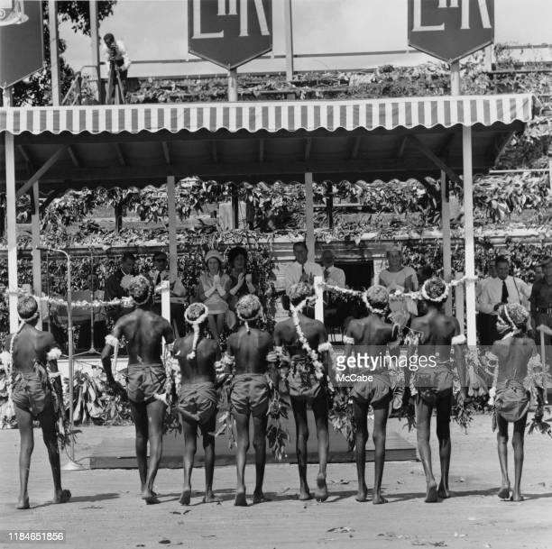 Queen Elizabeth II and Prince Philip, Duke of Edinburgh applaud a display by Aboriginal Australians during their tour of Australia, 1963.